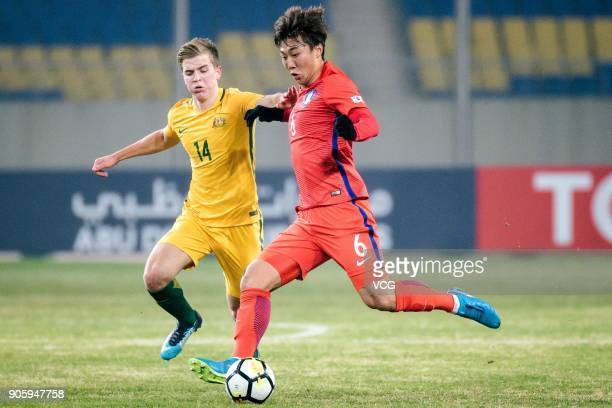 Hwang KiWook of South Korea and Riley McGree of Australia compete for the ball during the AFC U23 Championship Group D match between South Korea and...