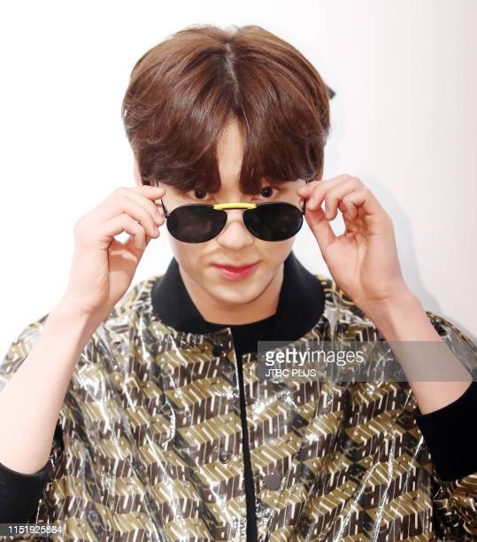 Hwang Min Hyun the group's NU'EST at the launching event for the Gentle Fendi collaboration collection held at the Gentlemonster flagship store in...