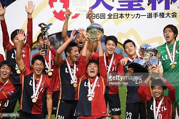 Hwang Seok Ho of Kashima Antlers lifts the Cup after the 96th Emperor's Cup final match between Kashima Antlers and Kawasaki Frontale at Suita City...