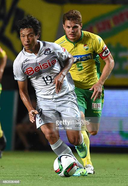 Hwang Songsu of Thespa Kusatsu and Paulinho of JEF United compete for the ball during the JLeague second division match between JEF United Chiba and...