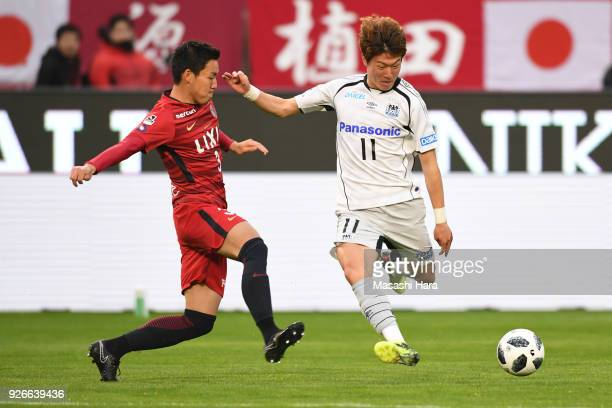 Hwang Ui Jo of Gamba Osaka and Gen Shoji of Kashima Antlers compete for the ball during the JLeague J1 match between Kashima Antlers and Gamba Osaka...