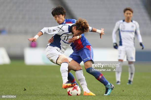 Hwang Ui Jo of Gamba Osaka and Sei Muroya of FC Tokyo compete for the ball during the JLeague J1 match between FC Tokyo and Gamba Osaka at Ajinomoto...