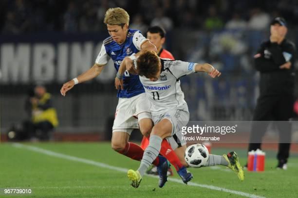 Hwang Ui Jo of Gamba Osaka and Takahiro Ogihara of Yokohama FMarinos compete for the ball during the JLeague J1 match between Yokohama FMarinos and...