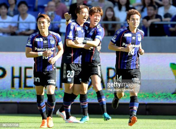 Hwang Ui Jo of Gamba Osaka celebrates scoring the opening goal with his team mates during the JLeague Levain Cup playoff first leg match between...