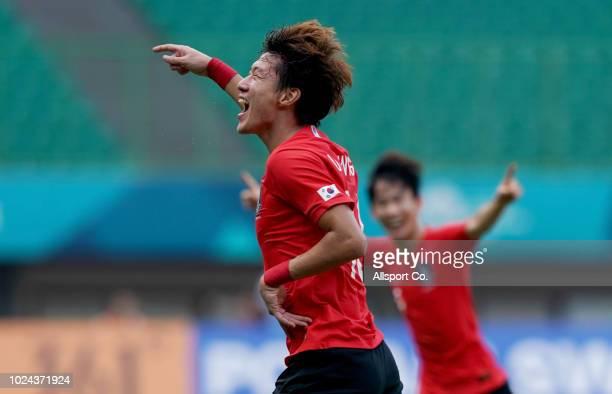 Hwang UI Jo of South Korea celebrates after he scored their 2nd goal duing the Men's Football Competition Quarter Finals match between Uzbekistan and...
