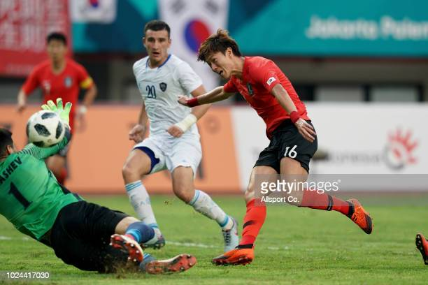 Hwang UI Jo of South Korea shoots and scored their 3rd goal during the Men's Football Competition Quarter Finals match between Uzbekistan and South...