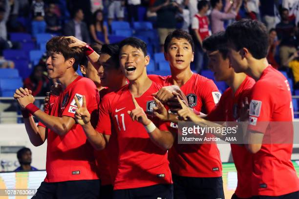 Hwang Uijo of South Korea celebrates scoring a goal to make it 10 with his teammates during the AFC Asian Cup Group C match between South Korea and...