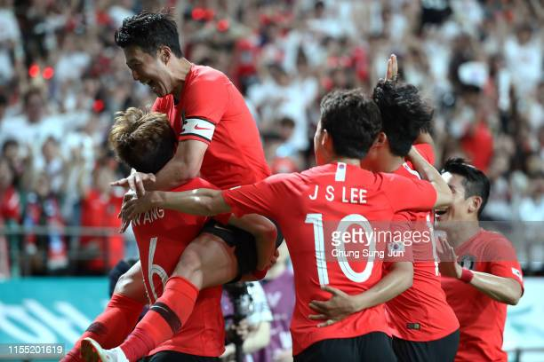 Hwang UiJo of South Korea celebrates with team mate Son HeungMin after scoring their first goal during the international friendly match between South...