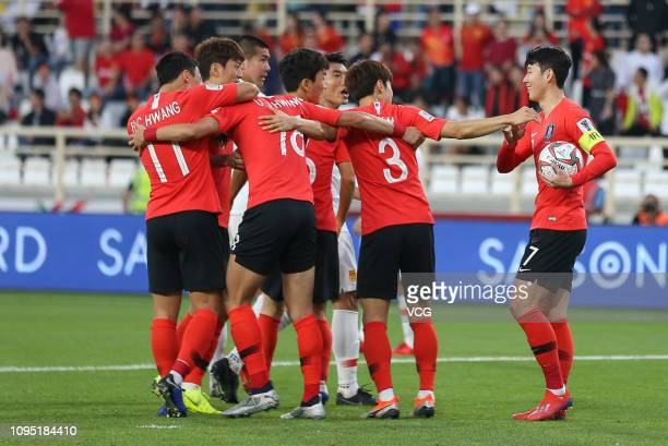 Hwang Ui-jo of South Korea celebrates with team mates after scoring his team's first goal with a penalty during the AFC Asian Cup Group C match...