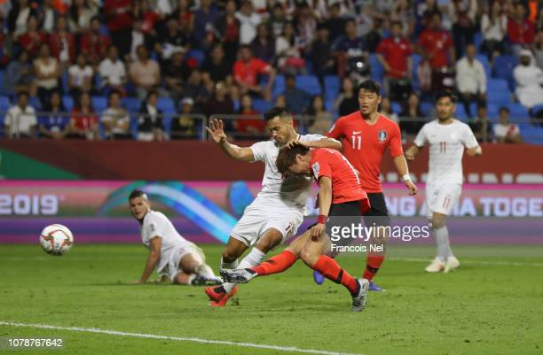 Hwang UiJo of South Korea takes a shot at goal during the AFC Asian Cup Group C match between South Korea and Philippines at Al Maktoum Stadium on...