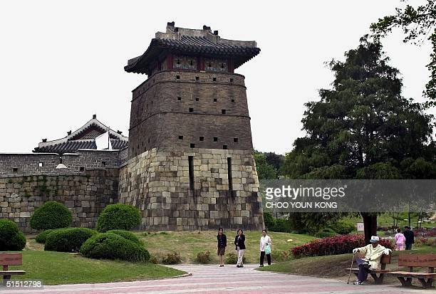 Hwaseong built in 17761800 during the Joseon Dynasty surrounds Suwon city some 46 km south of Seoul 11 May 2001 Known for its unsurpassed artistic...