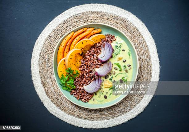 hyacinth bean curry bowl on woven mat - filipino culture stock pictures, royalty-free photos & images