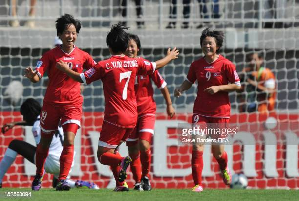Hyang Kyong Ri of Korea DPR celebrates with teammates after scoring a goal during the FIFA U17 Women's World Cup 2012 group B match between Korea DPR...