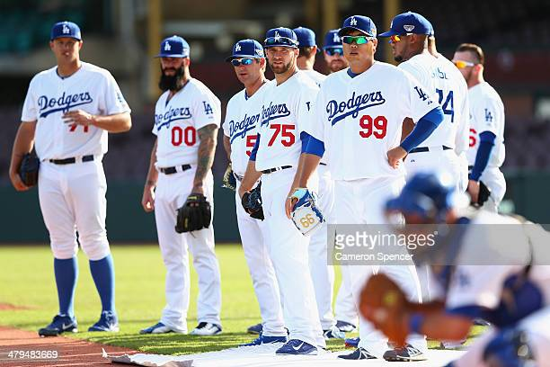 HyanJin Ryu of the Dodgers and team mates prepare for a drill during a Los Angeles MLB training session at Sydney Cricket Ground on March 19 2014 in...