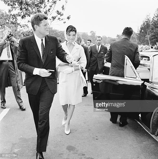 President Kennedy and First Lady shown entering St Francis Xavier churchyard prior to attending Mass