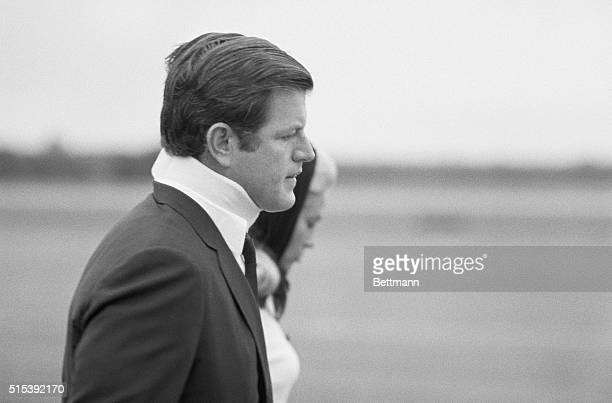 Senator Edward M Kennedy wearing an orthopedic collar is shown with his wife Joan as they head toward plane which will take them to the funeral of...