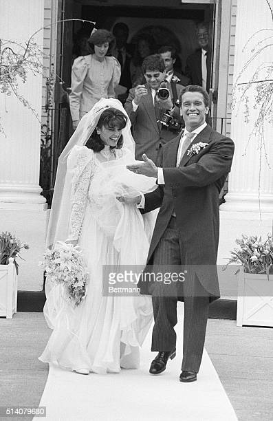 Hyannisport, MA: Arnold Schwarzenegger is all smiles as he introduces his new bride Maria Shriver Schwarzenegger as they leave St. Francis Xavier...
