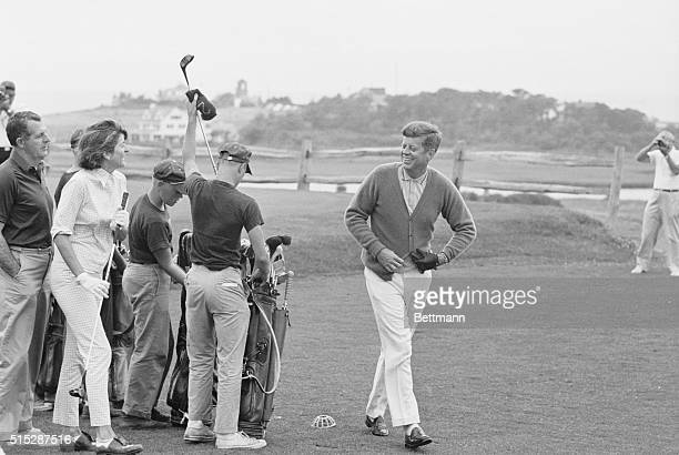 President Kennedy smiles at sister Pat after driving off the first tee here today The President and Pat Mrs Peter Lawford played a short round of...