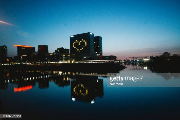 Hyatt Regency Hotel in Duesseldorf illuminates rooms which form a heart during the coronavirus crisis in Duesseldorf Germany on April 11 2020 during...