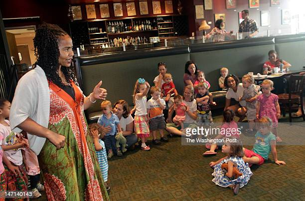 Musician and storyteller Bashea'Iya' Imana performs at Busboys and Poets in HyattsvilleMD on June 2012