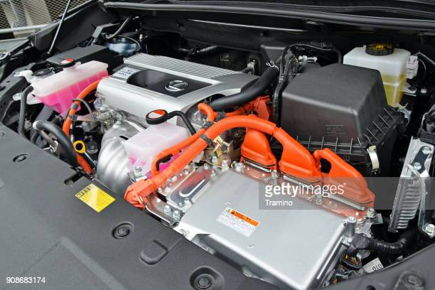 hybrid engine in a modern suv - hybrid car stock photos and pictures