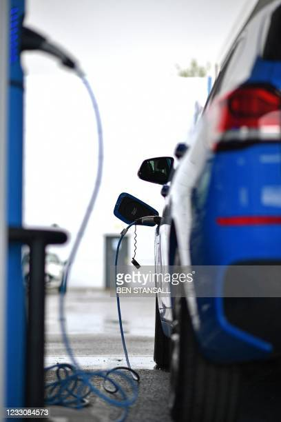 Hybrid is recharged at the BMW showroom in Tunbridge Wells, south-east of London, on May 24, 2021. - Energy regulator Ofgem has announced on Monday...