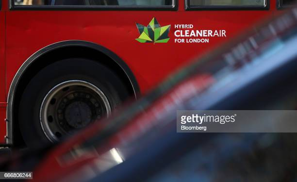 A hybrid powered bus displaying a 'Cleaner Air' sign stands in traffic in London UK on Monday April 10 2017 London has missed by seven years legal...