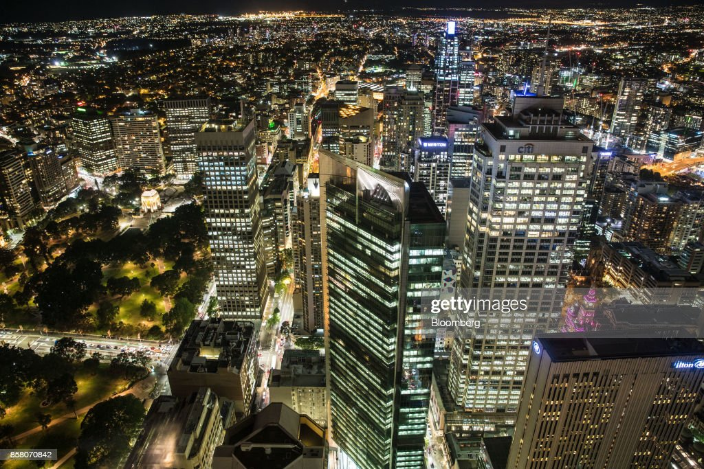 Hyde Park, left, and buildings in the financial district stand illuminated at night in Sydney, Australia, on Friday, Sept. 29, 2017. A bungled transition from coal to clean energy has left resource-rich Australia with an unwanted crown: the highest power prices in the world. Photographer: Cole Bennetts/Bloomberg via Getty Images