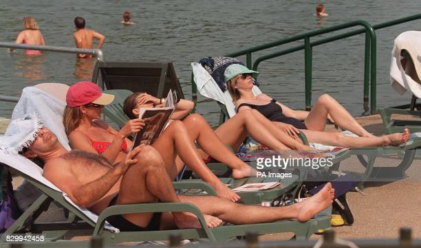 Hyde Park's Serpentine pool helps to keep the public cool in the Capital today Britain was sizzling with temperatures set to reach their hottest so...