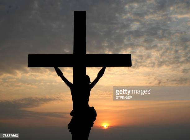 A sillouette of a depiction of the crucifixtion of Jesus Christ is seen at Wesley Church on the outskirts of Hyderabad early 08 April 2007 Easter is...