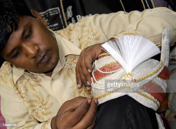 An Indian designer makes a 'Paghdi' groom's cap which is especially made for Hindu and Muslim weddings at his workshop in the old city of Hyderabad...