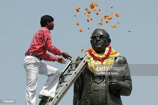 An Indian Subash Chander places flowers on the statue of B R Ambedkar on the occassion of his birth anniversay at Amritsar 14 April 2007 Ambedkar...