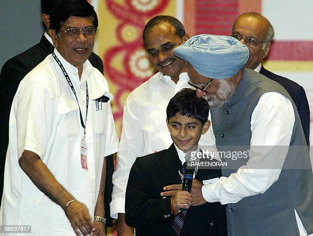 Indian Prime Minister Manmohan Singh greets Thailandbased Master Ajay Puri a young web designer as Indian Minister for Overseas Indian Affairs Oskar...