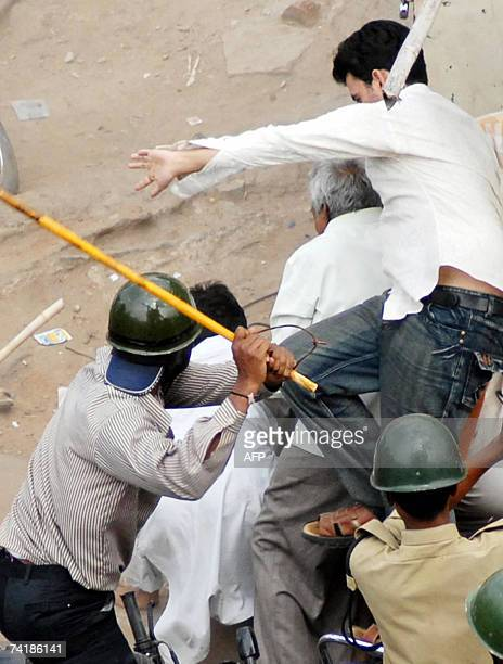Police beat protestors who pelted stones outside the Macca Masjid in Hyderabad 18 May 2007 following a bomb blast A bomb tore through one of India's...