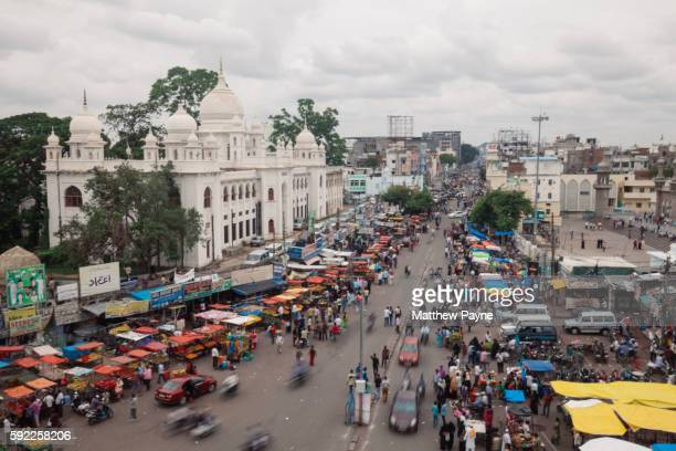 Hyderabad, India: Traffic moves down a highway in the old city near Charminar