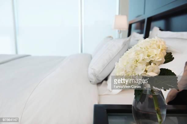 Hydrangea in vase on bedside table
