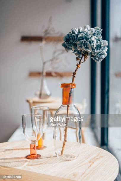 hydrangea with stalk in a glass jug with and wine glasses. - fashion stock pictures, royalty-free photos & images