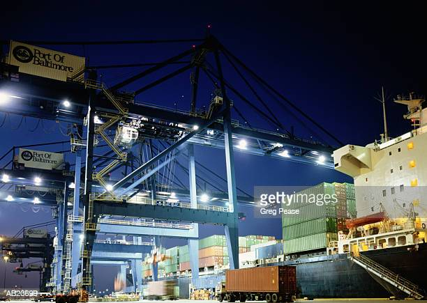 """hydraulic cargo crane loading freighter, night, low angle view - """"greg pease"""" stock pictures, royalty-free photos & images"""