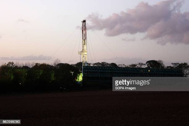 Hydraulic Fracking Rig some hundred yards from AntiFracking protests and owned by Third Energy starts its evening operating lights as night draws in...