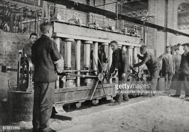 Hydraulic test of medium grenades in an ammunition factory Italy World War I from L'Illustrazione Italiana Year XLIII No 14 April 2 1916