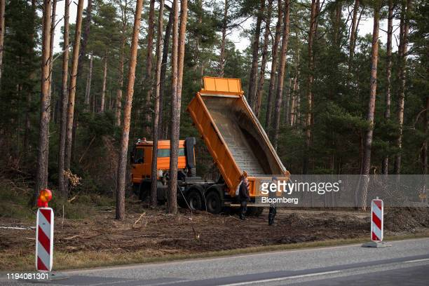 A hydraulic truck sits on a forest access road during groundworks for the Tesla Inc Gigafactory in Gruenheide Germany on Monday Jan 13 2020 Elon Musk...