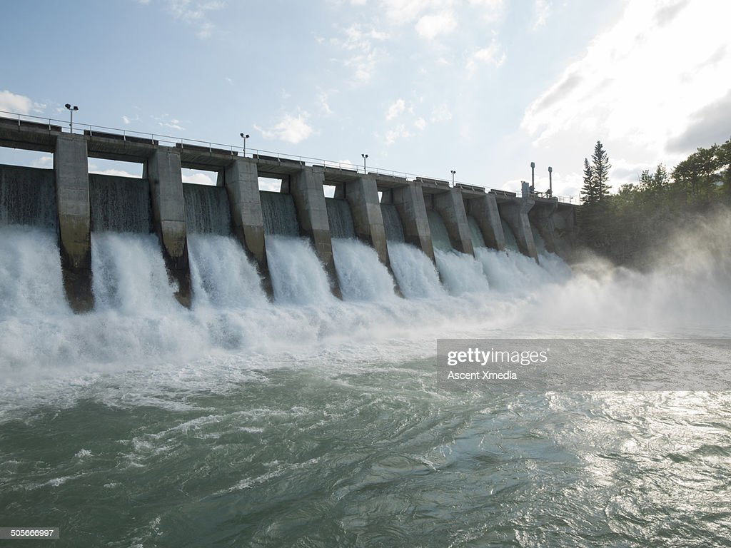 Hydroelectric dam during Spring runoff, full water : Stock Photo