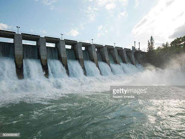 hydroelectric dam during spring runoff, full water - dam stock pictures, royalty-free photos & images
