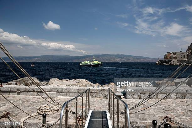 A hydrofoil passenger ferry arrives at the harbor in Hydra Greece on Monday May 11 2015 Less than three weeks after a Greek aid meeting broke up in...
