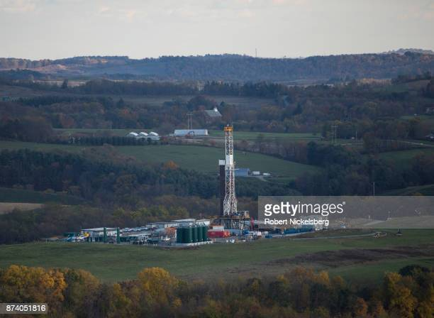 A hydrofracking drilling pad for oil and gas operates October 26 2017 in Robinson Township Pennsylvania The Kendal well pad is using a horizontal...