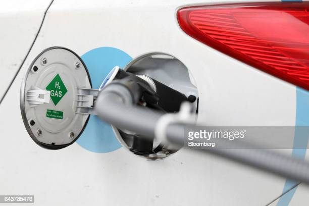 A hydrogen fuel pump fills a hydrogen powered car at Royal Dutch Shell Plc's first UK hydrogen refueling station in Cobham UK on Wednesday Feb 22...