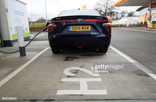 A hydrogen fuel pump sits attached to a Mirai hydrogen fuel powered automobile manufactured by Toyota Motor Corp on the forecourt at Royal Dutch...
