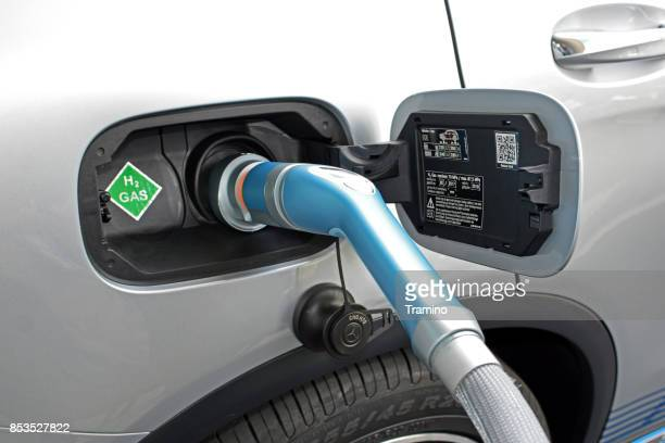 hydrogen refueling on the hydrogen filling station on the motor show - fossil fuel stock photos and pictures
