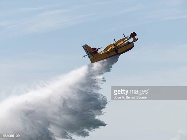 hydroplane unloading water - slash and burn stock pictures, royalty-free photos & images