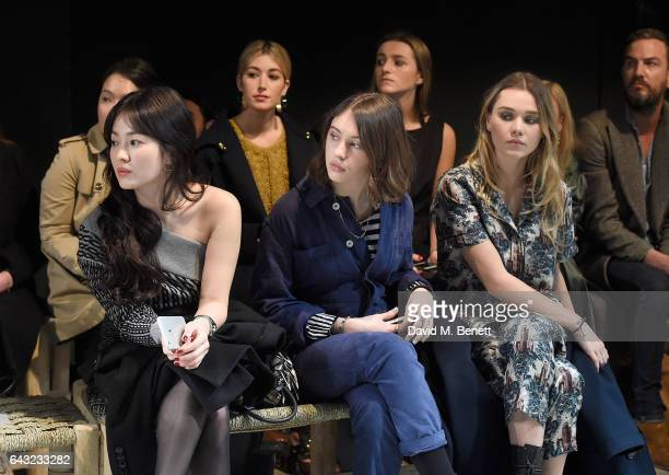 Hye Kyo Song Iris Law and Immy Waterhouse wearing Burberry attend the Burberry February 2017 Show during London Fashion Week February 2017 at Makers...